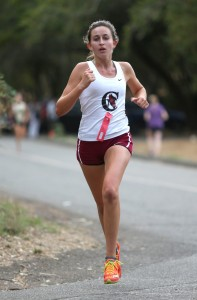 Cardinal Newman's Kasey Braun finishes in third place during the first NBL center meet at Spring Lake, in Santa Rosa, on Wednesday, October 7, 2015.   (Christopher Chung/ The Press Democrat)