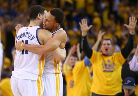 If I had to pick a favorite image of the year, I suppose this is it. It's of Golden State Warriors guards Stephen Curry and Klay Thompson celebrating their win over the Houston Rockets during Game 2 of the NBA Playoffs Western Conference Finals at Oracle Arena, in Oakland on Thursday, May 21, 2015. While shooting sports, I have to keep reminding myself to keep shooting after the action ends. A lot of photographers are much better than I am at doing that. I shoot a lot of sports, but I don't consider myself a sports shooter. I think I got it right here. It shows the jubilation of a one-point win, and the cheering crowd in the background. It's a storytelling image. It's what I strive for in this work. (Christopher Chung/ The Press Democrat)