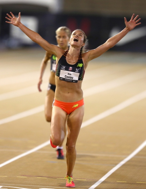Kim Conley throws her arms up in celebration as she wins the 10,000 meter race at the USA Track and Field Outdoor Championships in Sacramento on Thursday, June 26, 2014. (Christopher Chung/ The Press Democrat)