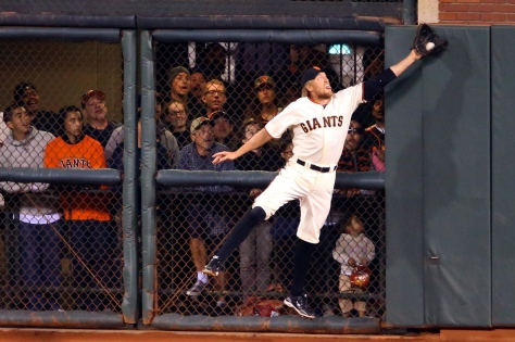 San Francisco Giants right fielder Hunter Pence grabs a fly ball by Washington Nationals batter Jayson Werth in the sixth inning, during Game 4 of the National League Division Series in San Francisco on Tuesday, October 7, 2014. (Christopher Chung/ The Press Democrat)