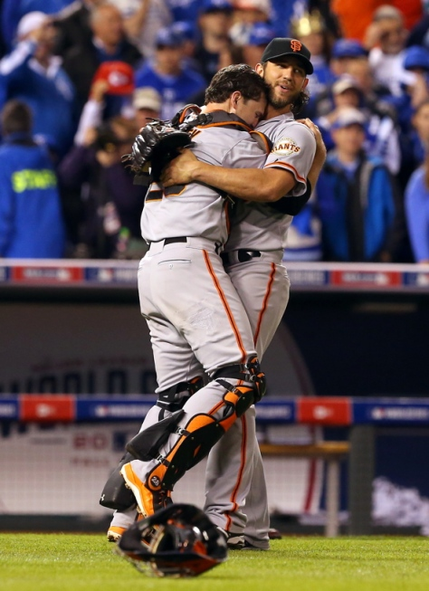 San Francisco Giants Buster Posey and Madison Bumgarner embrace after winning Game 7 of the World Series against the Kansas City Royals, in Kansas City on Wednesday, October 29, 2014. (Christopher Chung/ The Press Democrat)